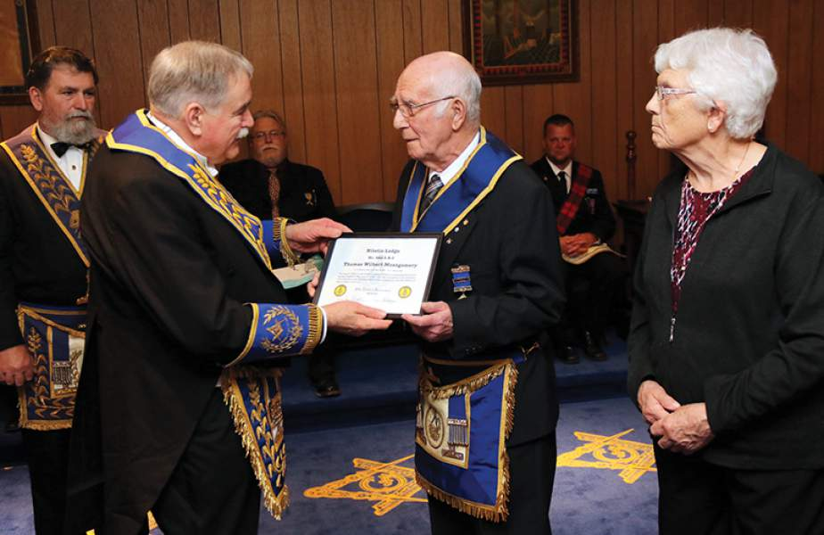 Mason honoured for 50 years' service