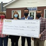 Sunrise Homes donates to Food Bank